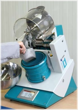 Operator filling powder into an Eirich mixer L1